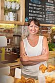 Portrait smiling cafe owner