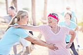 Yoga instructor helping senior woman