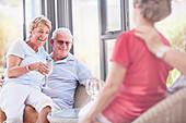 Senior couples drinking wine