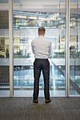 Businessman standing at office window