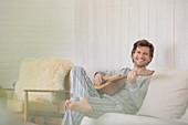 Man in pyjamas playing guitar