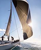 Wind pulling sail on sailboat
