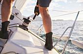 Man on heeling sailboat