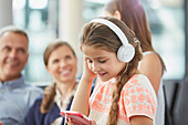 Girl listening to music with mp3 player
