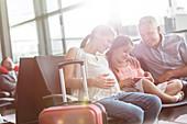 Pregnant family using digital tablet waiting