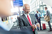 Businessman texting with cell phone