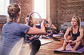 Fitness instructor explaining pilates ring
