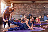 Fitness instructor helping young woman