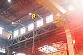 Chain hanging from crane in steel factory