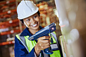 Smiling female worker using scanner