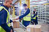 Workers scanning and processing boxes