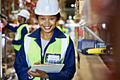 Portrait smiling female worker with clipboard