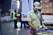 Truck driver worker scanning pallet