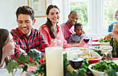 Woman enjoying Christmas dinner with family
