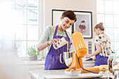 Female caterer baking, using stand mixer