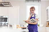 Female caterer with cookbook baking