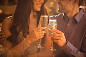 Affectionate couple toasting champagne flutes