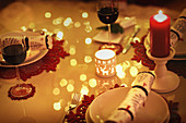 Red wine and candles on Christmas dinner table