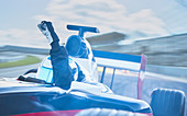 Formula one race car driver cheering