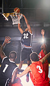 Young basketball player dunking the ball