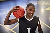 Confident basketball player holding basketball