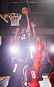 Young basketball players playing basketball