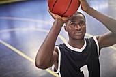 Focused basketball player shooting the ball