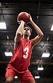Focused basketball player shooting free throw