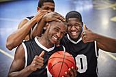 Portrait basketball player team celebrating