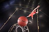 Young basketball player shooting the ball on court