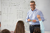 Smiling male science teacher leading lesson