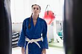 Portrait young woman wearing jiu-jitsu uniform