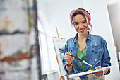 Portrait artist with paintbrush and palette
