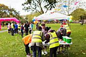 Volunteers checking runners in
