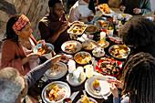 Family enjoying Caribbean Christmas dinner