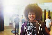 Portrait confident, cool teenager in dance class studio
