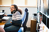 Portrait smiling creative businessman working in office