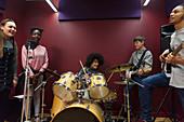 Teenage musicians recording music