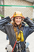 Portrait smiling young woman preparing to zip line