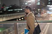 Businessman, walking on bridge at night