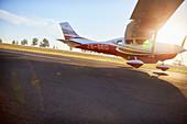 Propeller airplane landing on sunny tarmac
