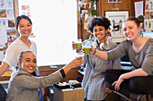 Female designers drinking green smoothies
