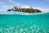 Tropical island beyond idyllic blue ocean water