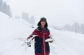 Portrait boy with drone in snowy landscape