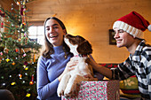 Brother and sister with dog in Christmas gift box