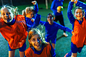 Portrait girls soccer team cheering