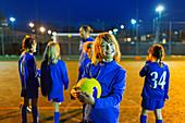 Portrait smiling, girl enjoying soccer practice