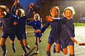 girls soccer team running and celebrating