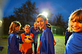 Portrait smiling girls soccer team