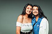Portrait twin teenage sisters